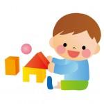 積み木で遊ぶ少年