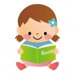 本を読む保育園児の女の子
